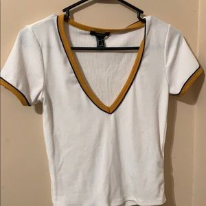 White v neck crop top with yellow and blue sleeves